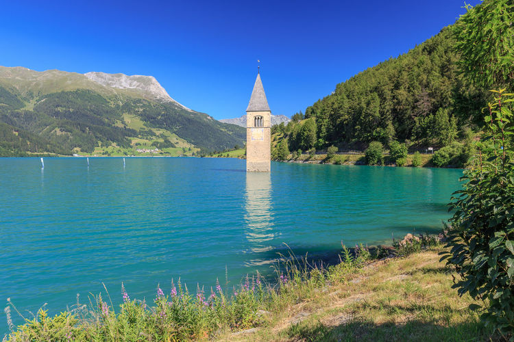 Campanile di Curon in the lago di Resia Water Architecture Built Structure Plant Mountain Sky Building No People Nature Beauty In Nature Building Exterior Blue Tower Day Scenics - Nature Clear Sky Place Of Worship Outdoors Reschensee Lago Di Resia (Reschensee) Campanile Graun Im Vinschgau Lake Resia Lago Resia
