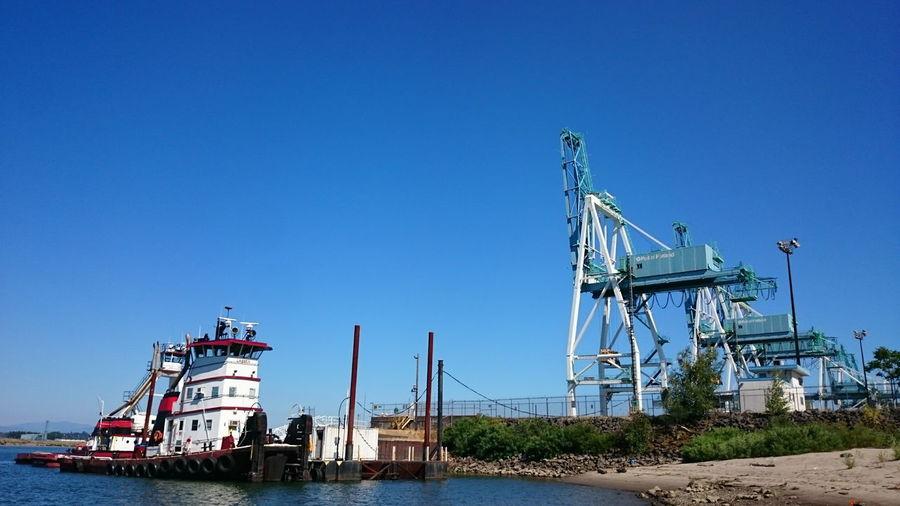Barge anchored at riverbank