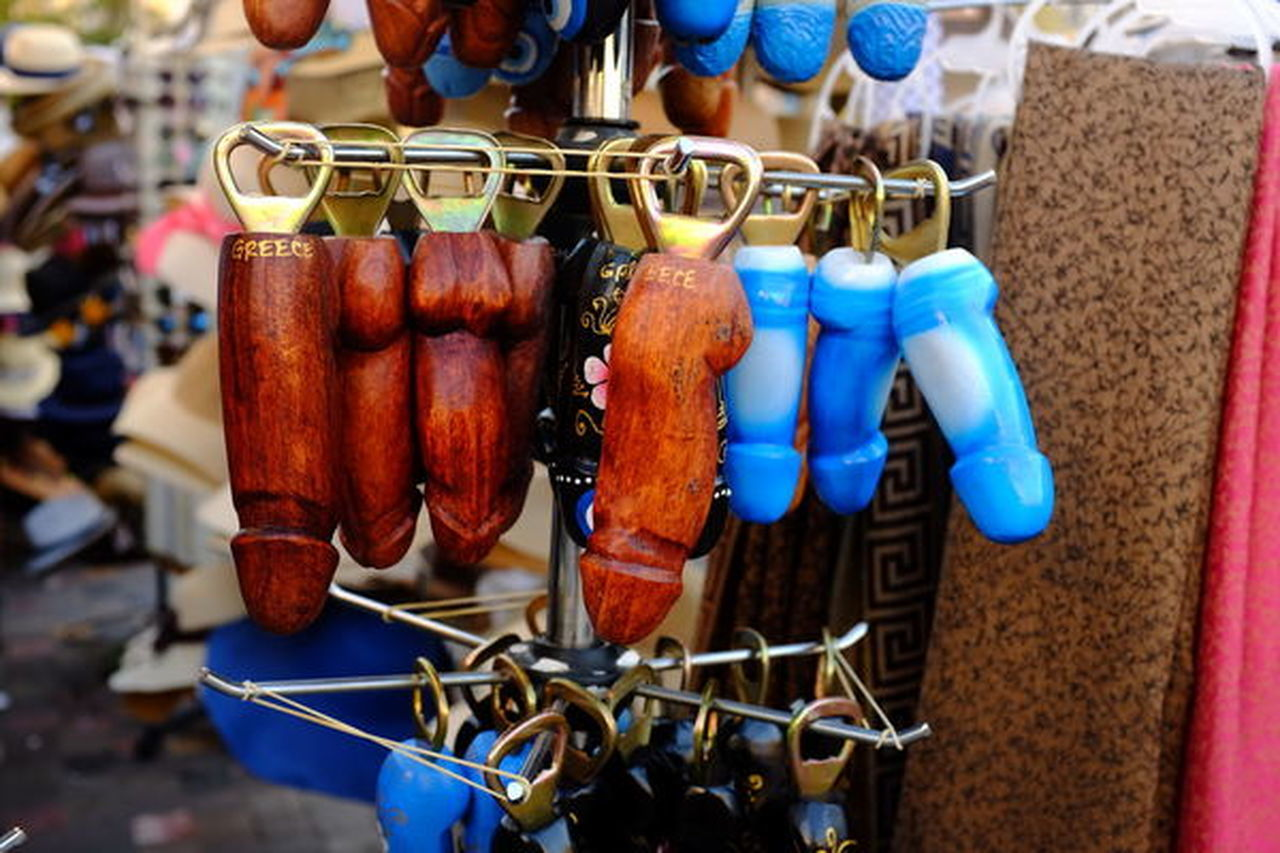 hanging, focus on foreground, retail, for sale, close-up, market, market stall, no people, day, large group of objects, choice, food and drink, side by side, arrangement, still life, retail display, blue, in a row, variation, sale, street market