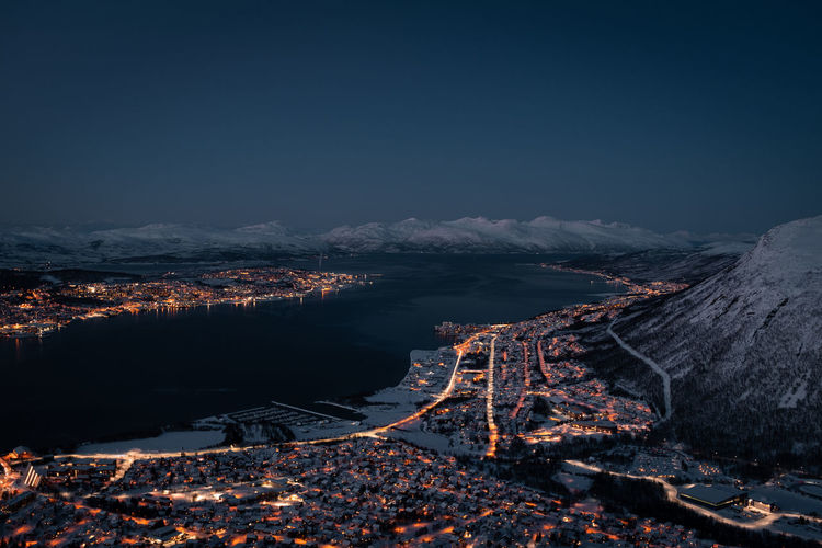 Tromsøysundet tromsø norway landscape and cityscape panorama with mountainous background in winter.