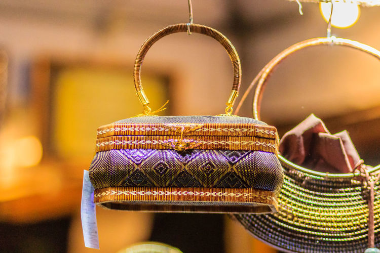 """Beautiful lady handbags and basketry that made from Lygodium (climbing fern), or """"Yan lipao"""" in Thai, the famous product from Southern Thailand for sale at night market, Bangkok. Night shot with grain Lygodium Yan Lipao Yanlipao Basketry Climbing Fern Close-up Day Fashion Gold Colored Handbag  Handbags Handbagshop Indoors  Jewelry Lady Handbag Lady Handbags Luxury No People"""