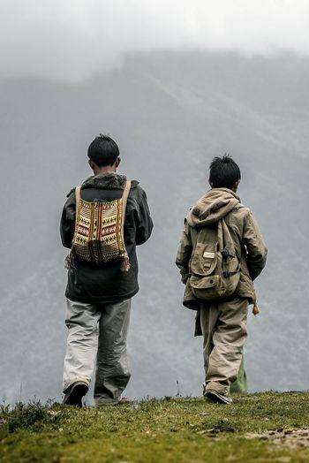 Portrait Arunachal Pradesh Trekking Fog People Travel Walking Cloud - Sky Backpack On The Edge Camouflage Clothing Full Length Men Rear View Hiking Pole Hiking Mountain Climbing Explorer Mountain Peak Human Connection