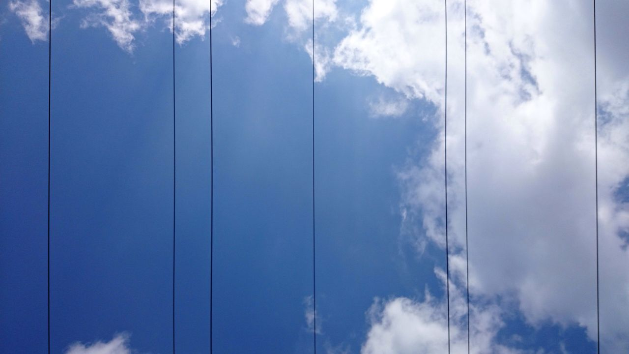 Directly below shot of power lines against sky