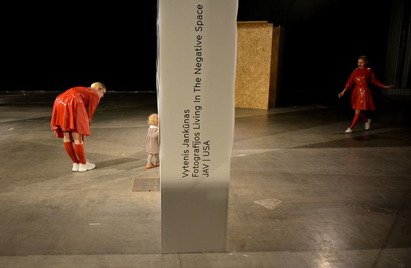 Rear view of people walking with text