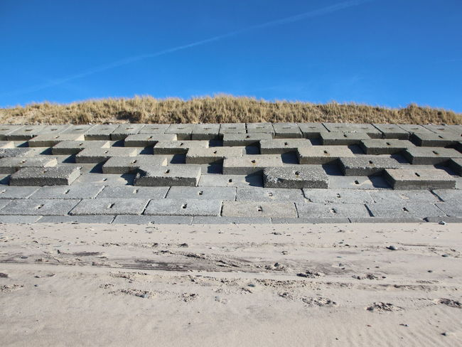 Concrete Blocks Flood Protection Weather Protection Beach Blue Sky Clear Sky Day Flooding History No People Outdoors Pattern Sky War
