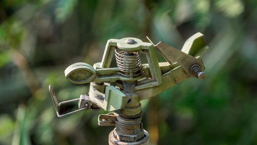 sprinkler closeup in garden Close-up Day Focus On Foreground Outdoors Sprinkler Sprinkler System SprinklerAdjustment Sprinklers
