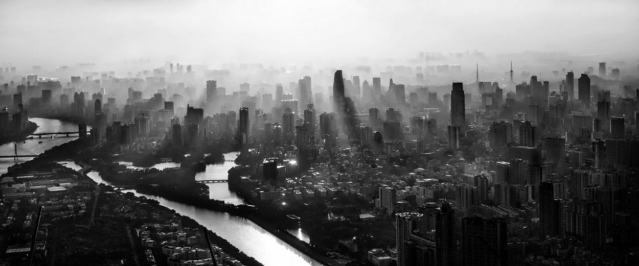 Panoramic view of cityscape in foggy weather