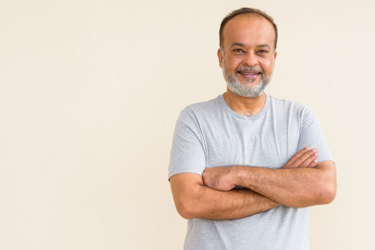 Portrait of a smiling man against white background