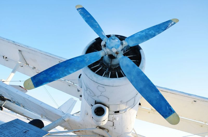 Low angle view of airplane propeller against sky