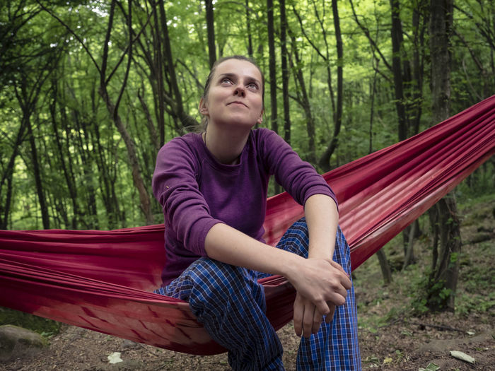 A little relax before the next climbing route. Beauty In Nature Casual Clothing Climbing Day Enjoying Life Forest Front View Girl Green Hammock Leisure Activity Lifestyles Nature One Person Outdoor Activity Outdoors People Relaxation Sitting Smiling Spring Tree Woman WoodLand Young Adult