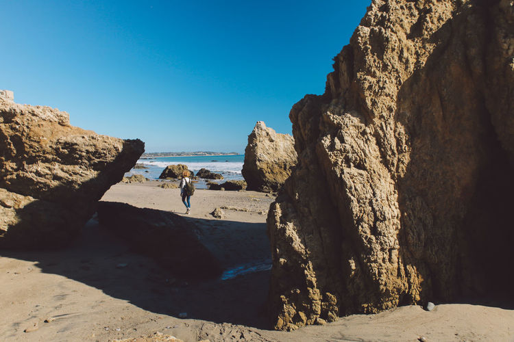 California El Matador Beach Pacific Beach Beauty In Nature Blue Clear Sky Cliff Coast Curly Hair Day Full Length Girl Leisure Activity Lifestyles Men Nature Ocean Outdoors Real People Rock - Object Rock Formation Scenics Sea Shadow Shore Sky Standing Sunlight Tranquil Scene Tranquility Vacations Women California Dreamin