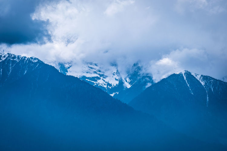 Mountain Beauty In Nature Cold Temperature Cloud - Sky Snow Winter Scenics - Nature Environment Tranquil Scene Tranquility Sky Nature Mountain Range Landscape Non-urban Scene No People Day Idyllic Snowcapped Mountain Outdoors Mountain Peak Meili DeQin Yunnan China Tibet Fog Cold Cool