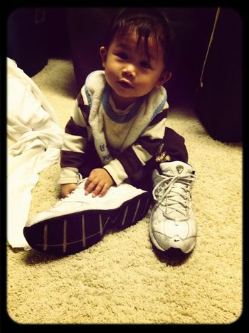 Gabriel wanted to try on Dad's shoes.