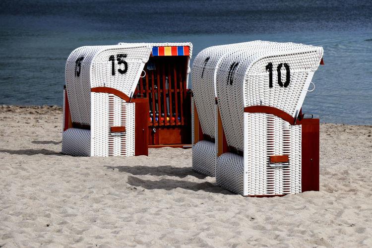 German beach basket chairs on a beach of a north sea - strandkorb