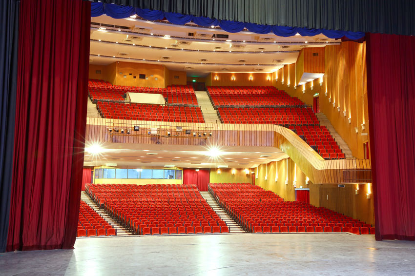 Backstage and empty seats in movie theater Architecture Arts Culture Arts Culture And Entertainment Auditorium Back Stage Built Structure Chairs Curtains Illuminated Indoors  Lighting Equipment Movie Theater No People Red Stage Stage - Performance Space Stage Curtains Stage Theater Stage-performance Space