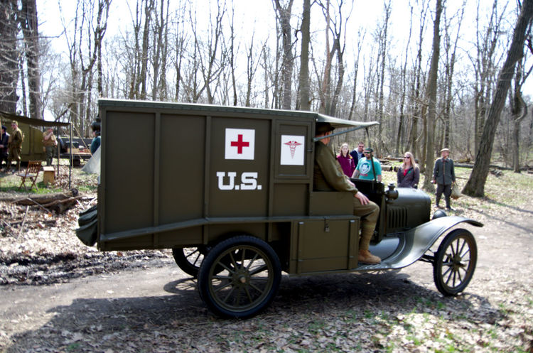 Old ambulance Adult Ambulance Day Full Length Men Outdoors People Real People Sitting Transportation Tree Wwi