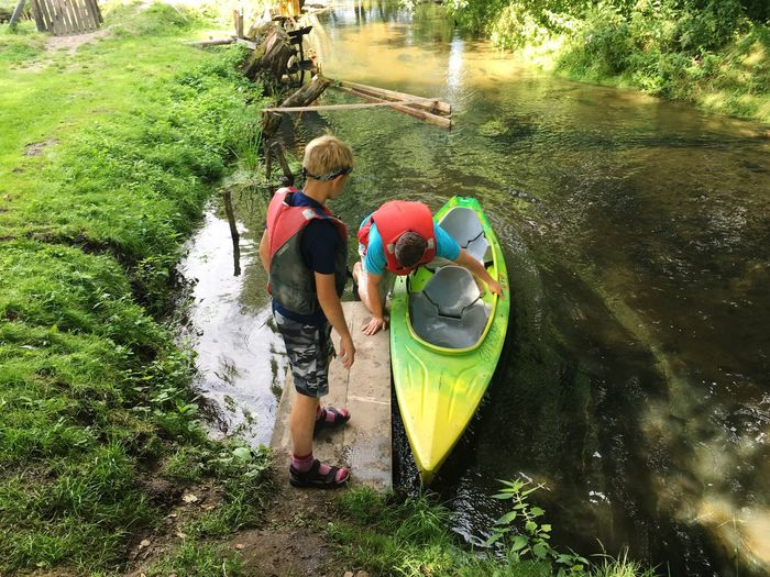 Real People High Angle View Water Day Leisure Activity Nature Togetherness Childhood Boys River Outdoors Elementary Age Lifestyles Rear View Full Length Men Transportation Vacations Standing Sitting Poland Bondyrz Kayak Kayaking