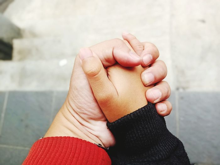 Close-up of hands holding baby hand