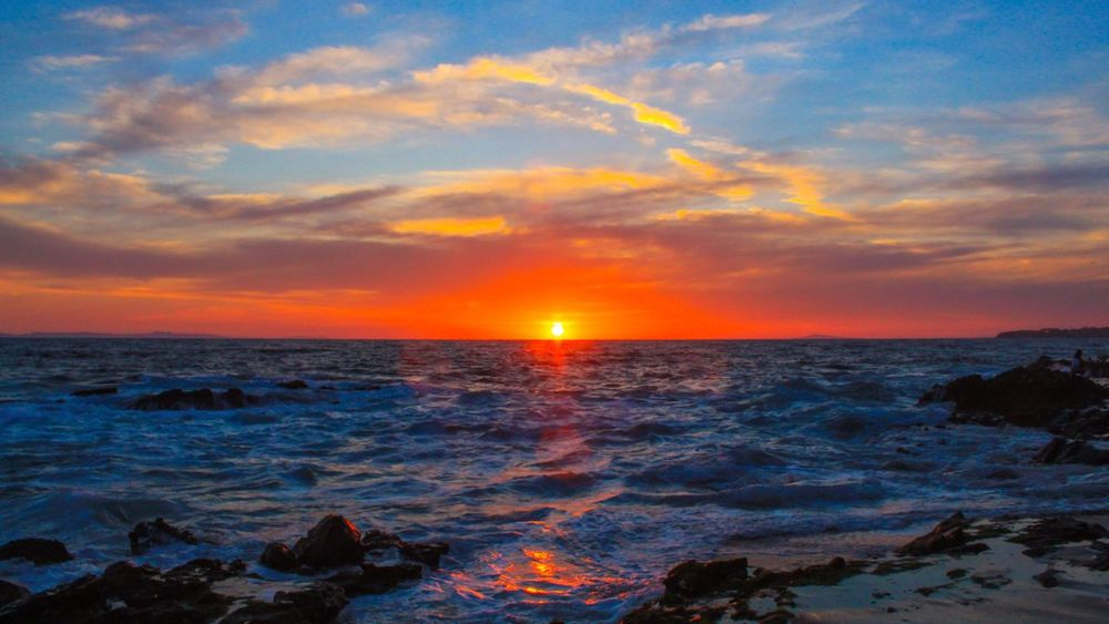Sea Sunset Water Beauty In Nature Horizon Over Water Scenics Nature Sun Orange Color Sky Tranquility Tranquil Scene No People Idyllic Wave Outdoors Beach