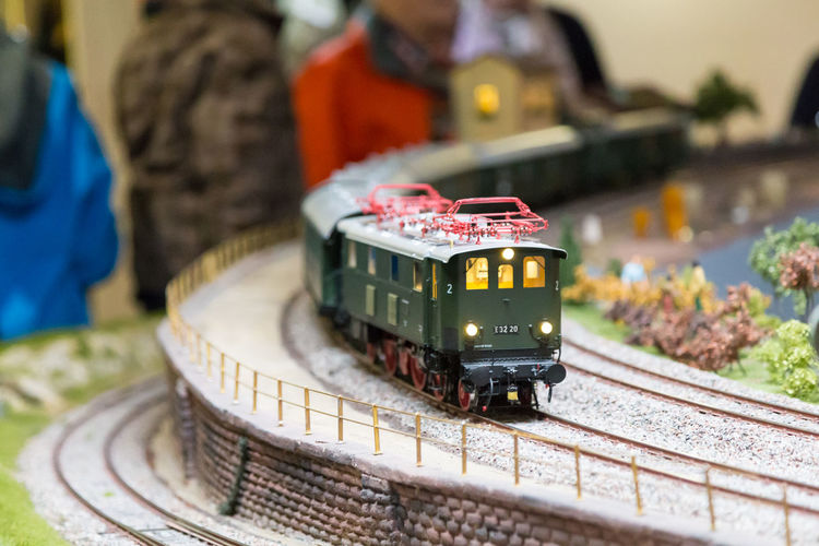 Close-up of toy car on railroad track