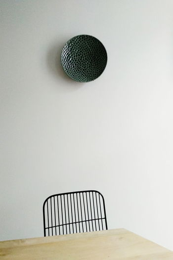 Metallic structure on table against wall ceramic