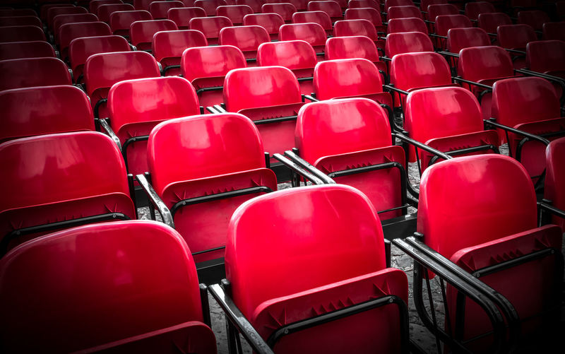 Full frame shot of empty red chairs
