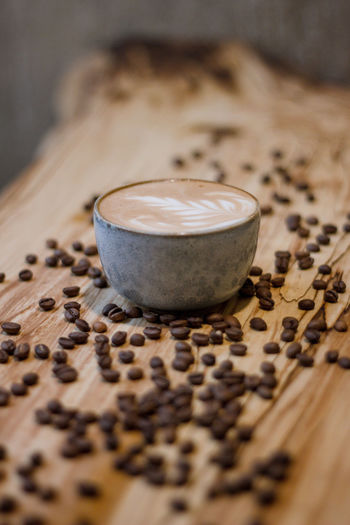 Coffee Coffee - Drink Coffee Cup Coffee Time Coffee Break Food And Drink Indoors  No People Drink Selective Focus Still Life Refreshment Food Cup Freshness Roasted Coffee Bean Cappuccino Table Mug Hot Drink Frothy Drink Close-up Caffeine Latte Crockery Non-alcoholic Beverage