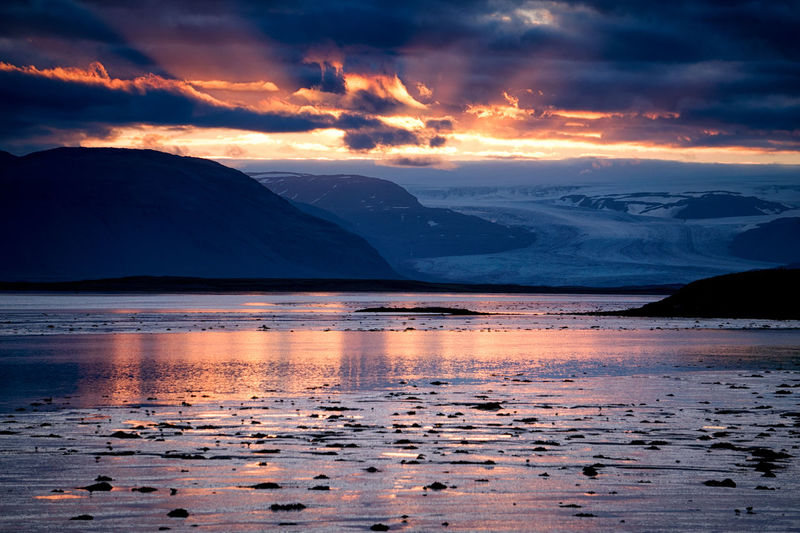 Sunset over the glaciers and mountains near Hofn, Iceland Beauty In Nature Cultures Dramatic Sky Glacier Iceal Iceland Mountain Mountains No People Outdoors Reflection Romantic Sky Sea Sea And Sky Sky Sunset Sunset_collection