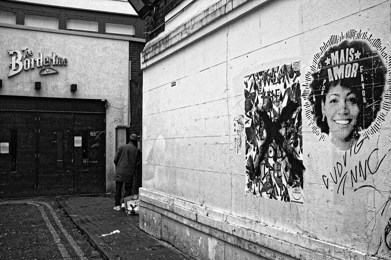 Man with graffiti on wall