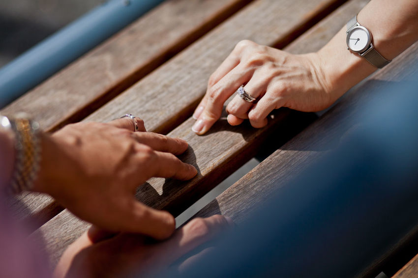 Connection Human Hand Hand Human Body Part Adult Wood - Material Occupation Communication Selective Focus High Angle View Close-up Women People Connection Day Fingers Relationship Couple Togetherness First Love Frindship Moments Of Happiness