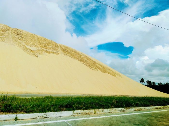 a huge sandy dune on the side of a road Road Sand Tropical Desert Hoy Mountain Sky Landscape Cloud - Sky Sand Dune Countryside