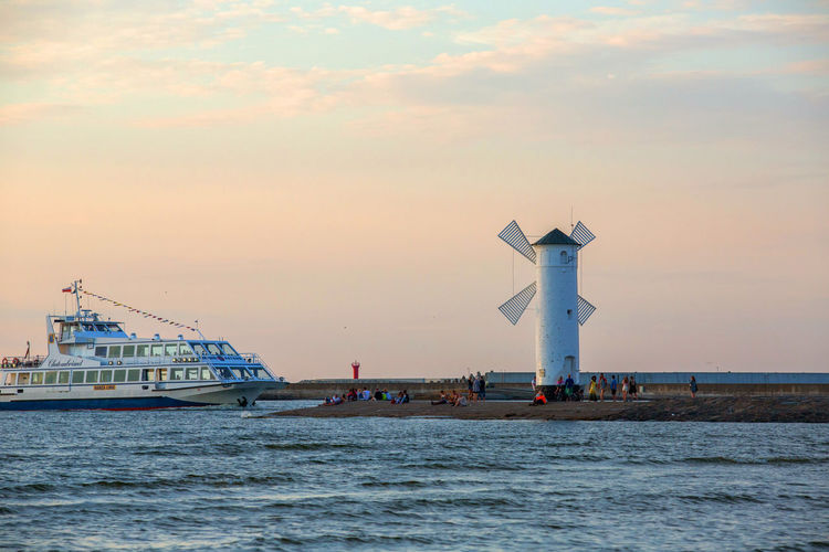 Baltic Sea Architecture Beauty In Nature Building Exterior Built Structure Cloud - Sky Lighthouse Mode Of Transportation Nature Nautical Vessel No People Outdoors Scenics - Nature Sea Ship Sky Sunset Transportation Water Waterfront