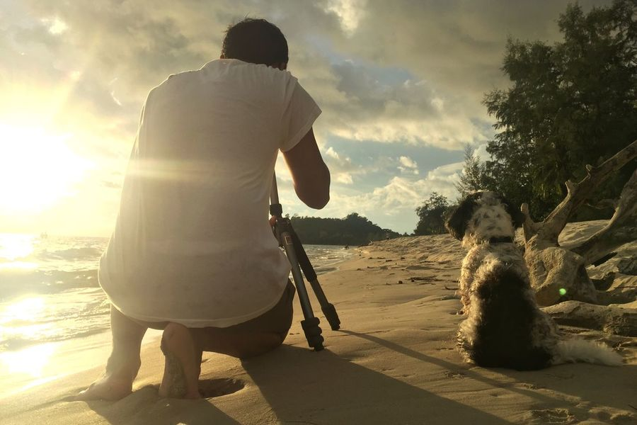 Asian  Full Length Sunlight Rear View Lifestyles Outdoors Domestic Animals Beauty In Nature Man And Dog Sunset Beach Dog Lover Dog Traveller