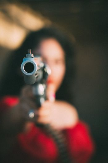 Blurred woman holding gun