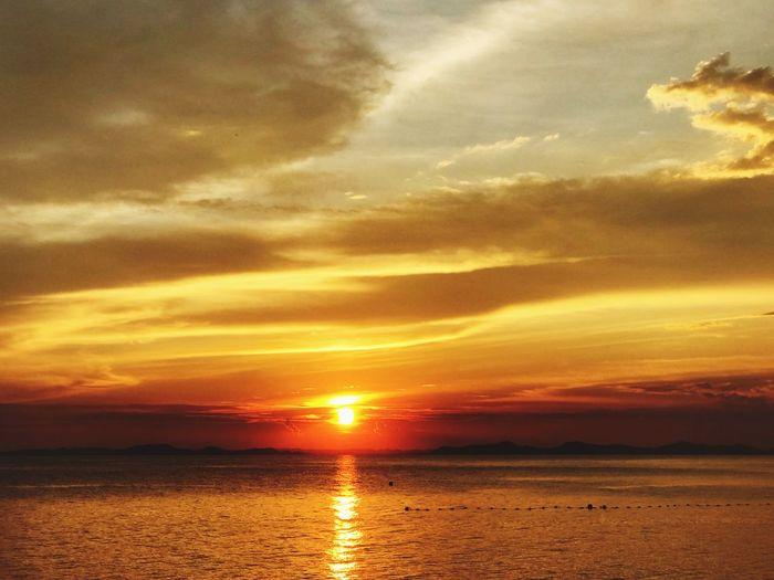 Sky Sunset Cloud - Sky Water Beauty In Nature Scenics - Nature Sea Horizon Tranquil Scene Tranquility Sunlight Nature Sun Dramatic Sky Reflection Orange Color Horizon Over Water Outdoors Idyllic