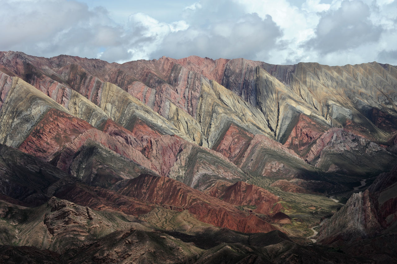 Andes Argentina Arid Climate Beauty In Nature Cloud - Sky Day Geology Hornocal Humahuaca Landscape Mountain Mountain Range Nature No People Outdoors Physical Geography Rock - Object Rock Formation Scenics Sky Textured  Tranquil Scene Tranquility Travel Destinations