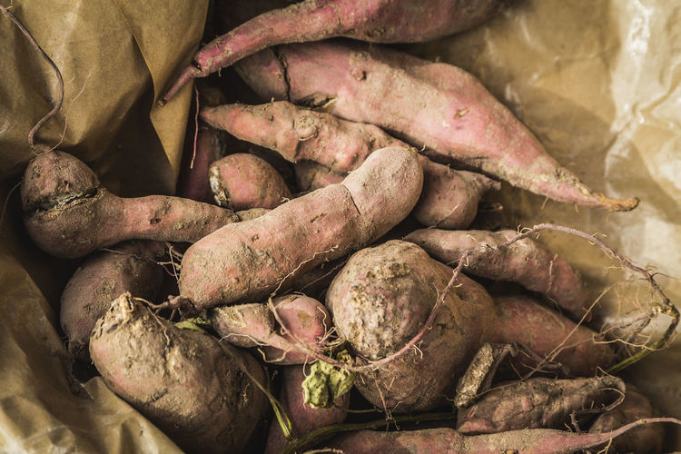 Close-up of sweet potatoes in paper bag