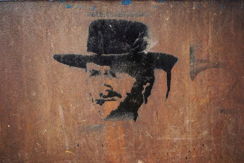 Metal Rusty Cowboy Man Graffiti Template Sunlight Day No People Creativity Black Color Outdoors Close-up Wall - Building Feature Representation Focus On Shadow