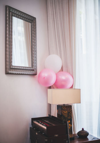 Balloons are a part of my staple decor. Indoors  Balloon Home Interior No People Window Wall - Building Feature Still Life Table Celebration Curtain Frame Decoration Day Domestic Room Picture Frame House Multi Colored Helium Balloon Home Event