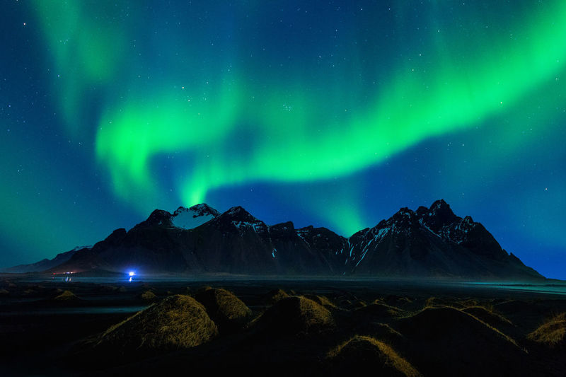 Scenic View Of Mountains Against Aurora Borealis At Night