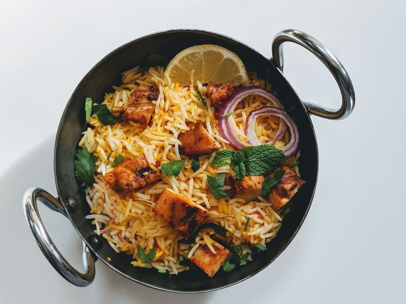 Chicken Tikka Biryani Chicken Tikka  Indian Food Styling Isolated On White Basmati Rice Grilled Non Veg Mint Leaves Food And Drink Food No People Healthy Eating Indoors  Cast Iron Close-up White Background Comfort Food Ready-to-eat Freshness