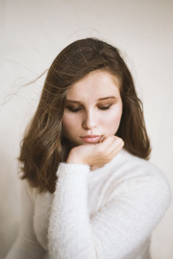 Young Adult One Person Young Women Indoors  Lifestyles Women Beautiful Woman Hair Looking Down Hairstyle Looking Long Hair Brown Hair Beauty Portrait Headshot Adult Real People Contemplation Warm Clothing