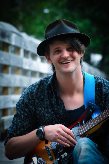 Portrait of young man wearing guitar