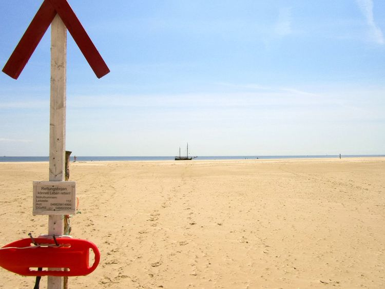 Beach Sand Sea Water Warning Sign Horizon Over Water Lifeguard  No People Travel Destinations Summer Nature Beachphotography Blue Cloud - Sky Amrum Lost In The Landscape Tranquil Scene Sunny Clear Sky Landscape Tranquility Sky Travel Beach Photography Perspectives On Nature Be. Ready.