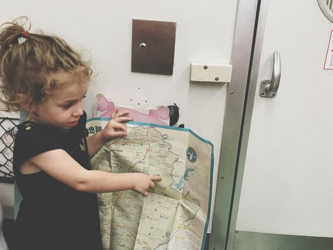Adventure Travelling Carte City Map Map Child Childhood One Person Real People Girls Indoors  Leisure Activity Standing Cute Waist Up Females Lifestyles Looking Holding Learning Innocence