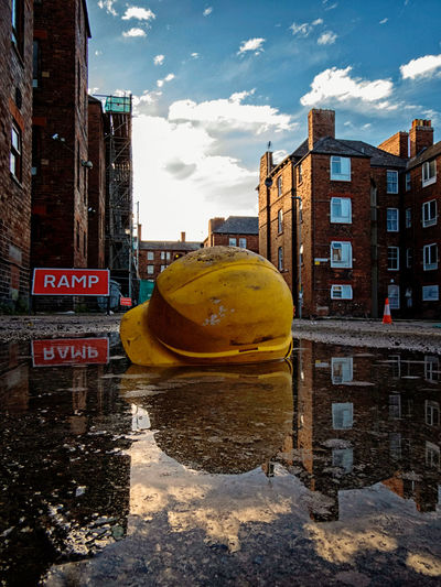 Your imagination is a weapon of mass construction. Use it! Residential District No People City Life Outdoors CreativePhotographer Eyeem Market EyeEm Gallery Colourful Colours Sunshine United Kingdom Great Britain Europe England Architecture Architecture_collection Puddle Reflections Puddle Safety Helmet Under Construction... Bauarbeiten Creativity Creative Photography Cityscape Road Work