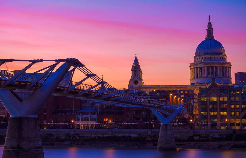 View of illuminated tower bridge against sky during sunset