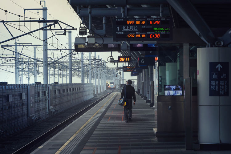 The Departure Alone Architecture Built Structure City Clock Communication Day Illuminated Journey Lonly Men One Person Outdoors Passenger People Public Transportation Rail Transportation Railroad Station Railroad Station Platform Railroad Track Real People Single Technology Transportation Travel