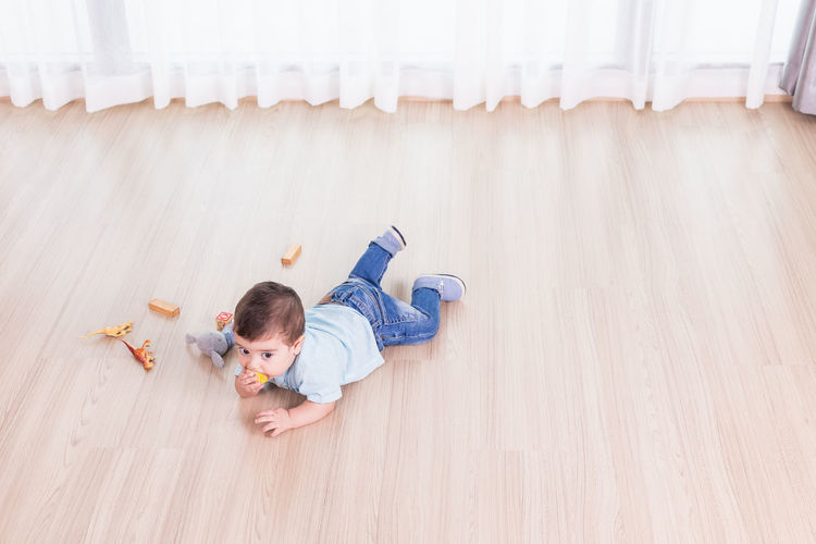 High angle view of stuffed toy on floor at home