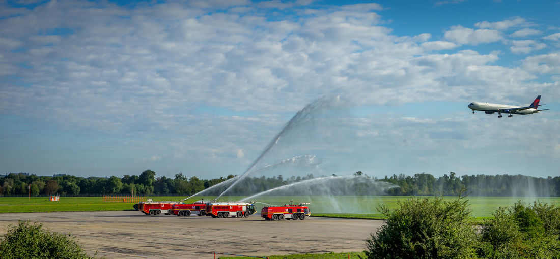 Transportation Sky Air Vehicle Water Airplane Motion Travel No People Outdoors Nautical Vessel Day on the move Airport Runway Plane Aircraft Water_collection Firebrigade Waterfountain Landing Landing - Touching Down